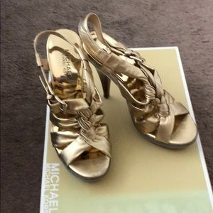 Like new! Gold leather Michael Kors sandals